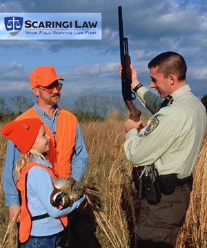 Ranger speaking to father and daughter about hunting safety