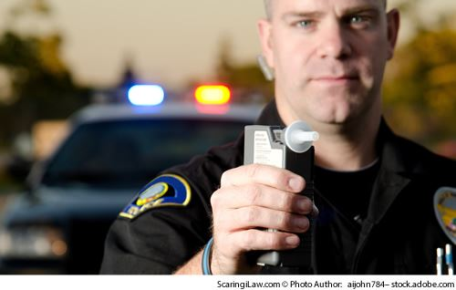 officer with a breathalizer
